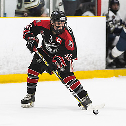 TORONTO, ON - APR 10, 2018: Ontario Junior Hockey League, South West Conference Championship Series. Game seven of the best of seven series between the Georgetown Raiders and the Toronto Patriots, Jaden Condotta #40 of the Georgetown Raiders tries to control a bouncing puck during the second period.<br /> (Photo by Kevin Raposo / OJHL Images)