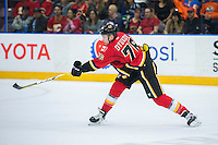 PENTICTON, CANADA - SEPTEMBER 17: Roman Dyukov #76 of Calgary Flames takes a shot against the Edmonton Oilers on September 17, 2016 at the South Okanagan Event Centre in Penticton, British Columbia, Canada.  (Photo by Marissa Baecker/Shoot the Breeze)  *** Local Caption *** Roman Dyukov;