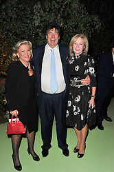 Left to right, ROS PACKER, ? and LADY ANNUNZIATA ASQUITH at a dinner hosted by Cartier in celebration of the Chelsea Flower Show held at Battersea Power Station, 188 Kirtling Street, London SW8 on 23rd May 2011.