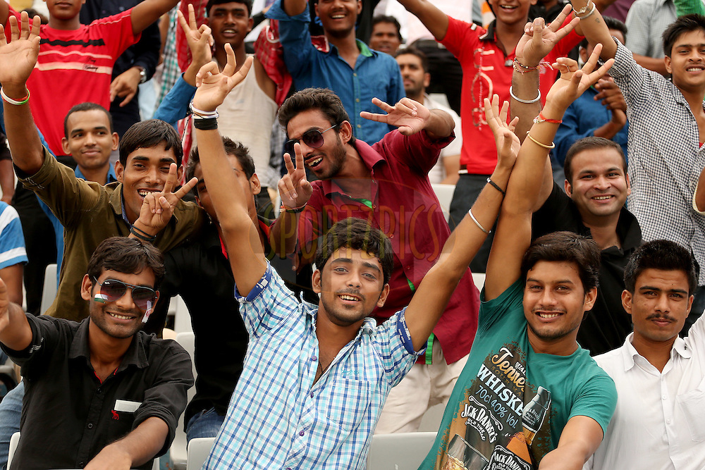 Crowd enjoying the atmosphere during match 4 of the Oppo Champions League Twenty20 between the Dolphins and the Perth Scorchers held at the Punjab Cricket Association Stadium, Mohali, India on the 20th September 2014. Photo by:  Jacques Rossouw / Sportzpics/ CLT20<br /> <br /> <br /> Image use is subject to the terms and conditions as laid out by the BCCI/ CLT20.  The terms and conditions can be downloaded here:<br /> <br /> http://sportzpics.photoshelter.com/gallery/CLT20-Image-Terms-and-Conditions-2014/G0000IfNJn535VPU/C0000QhhKadWcjYs