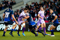 Henry Slade of Exeter Chiefs is tackled by Jono Ross of Sale Sharks - Mandatory by-line: Robbie Stephenson/JMP - 08/12/2019 - RUGBY - AJ Bell Stadium - Manchester, England - Sale Sharks v Exeter Chiefs - Heineken Champions Cup
