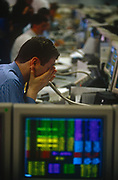 1990s traders look stressful on a city trading floor, on 29th March 1996, in London, England.