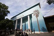 "Giardini, Palazzo delle Esposizioni. International exhibition ""Fare Mondi // Making Worlds // Bantin Duniyan // ???? // Weltenmachen // Construire des Mondes // Fazer Mundos..."" curated by Daniel Birnbaum. The facade with tropical palms and the sea designed by John Baldessari."