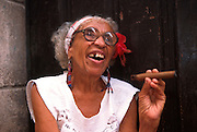 CUBA, HAVANA (HABANA VIEJA) Beautiful elderly lady smoking a Cuban cigar
