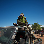 January 21, 2013 - Diabaly, Mali: A Mali army men take guard in Diabaly city centre, a day after the government troops regain control of the city. Diabaly was under islamist militants control since the 14th of January...Several insurgent groups have been fighting a campaign against the Malian government for independence or greater autonomy for northern Mali, an area known as Azawad. The National Movement for the Liberation of Azawad (MNLA), an organisation fighting to make Azawad an independent homeland for the Tuareg people, had taken control of the region by April 2012...The Malian government pledge to the French army to help the national troops to stop the rebellion advance towards the capital Bamako. The french troops started aerial attacks on rebel positions in the centre of the country and deployed several hundred special forces men to counter attack the advance on the ground. (Paulo Nunes dos Santos/Polaris)