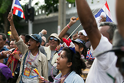 © Licensed to London News Pictures. 16/05/2014. PDRC protestors cheer during a rally outside Parliament in Bangkok Thailand where key senators were holding a meeting on May 16, 2014.  Photo credit : Asanka Brendon Ratnayake/LNP