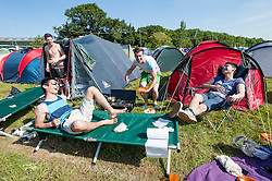 © Licensed to London News Pictures. 13/06/2014. Isle of Wight, UK.   A group of festival goers relax in the early morning sun at Isle of Wight Festival 2014 - today is expected to be the hottest day of the year in the UK.   The Isle of Wight festival is an annual music festival that takes place on the Isle of Wight. Photo credit : Richard Isaac/LNP