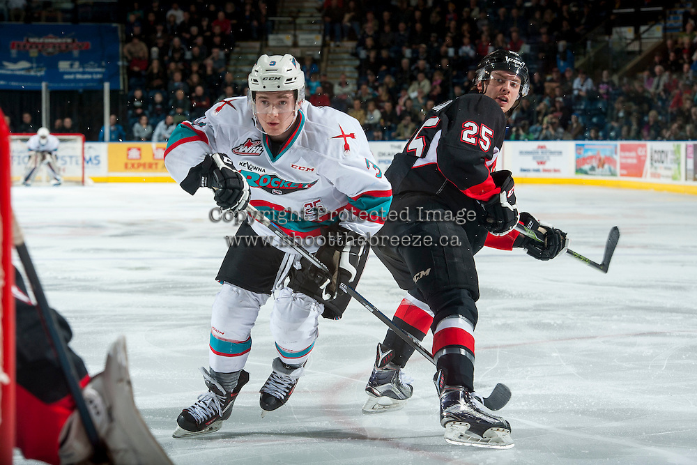 KELOWNA, CANADA - MARCH 9: Riley Stadel #3 of Kelowna Rockets skates around Tate Olson #25 of Prince George Cougars on March 9, 2016 at Prospera Place in Kelowna, British Columbia, Canada.  (Photo by Marissa Baecker/Shoot the Breeze)  *** Local Caption *** Riley Stadel; Tate Olson;
