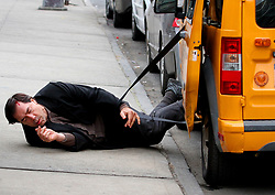 "Javier Bardem and Elle Fanning are seen filming an intense dramatic scene on the set of their upcoming movie ""Molly"" in Brooklyn. The scene involved Javier getting tangled and struggling to get out of a cab where he falls face first to the ground and bleeds from the forehead as his costar Elle Fanning is seen holding him and crying out for help. Javier will be playing a mental person and will be the father of his costar Elle Fanning. 16 Jan 2019 Pictured: Javier Bardem. Photo credit: LRNYC / MEGA TheMegaAgency.com +1 888 505 6342"