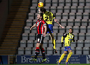 Peter Murphy loses out during the Sky Bet League 2 match between Morecambe and Dagenham and Redbridge at the Globe Arena, Morecambe, England on 1 December 2015. Photo by Pete Burns.