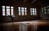 Emmanuel Malette practices in the Mary Channing Coleman Building on the UNCG campus, Thursday, October 22, 2015, in Greensboro, N.C. <br /> <br /> SCOTT MUTHERSBAUGH and JERRY WOLFORD / Perfecta Visuals<br /> <br /> When Emmanuel was a teenager, he went through lots of hard family situations. He needed an escape. That&rsquo;s when he turned to dance. Emmanuel describes his love with dance as being a safe haven.<br /> &nbsp;<br /> Growing up, he didn&rsquo;t have the money to pay for dance lessons so he would watch YouTube videos to try to pick things up from there. He would also dance with his cousin each summer.<br /> &nbsp;<br /> Emmanuel is now a senior at UNCG studying dance concentrating on performance and choreography. He loves all styles of dance but is most experienced in hip-hop and contemporary styles. Emmanuel also teaches dance classes at Artistic Motion.<br /> &nbsp;