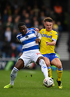 Football - 2018 / 2019 FA Cup - Third Round: Queens Park Rangers vs. Leeds United<br /> <br /> Queens Park Rangers' Bright Osayi-Samuel holds off the challenge from Leeds United's Jamie Shackleton, at Loftus Road.<br /> <br /> COLORSPORT/ASHLEY WESTERN