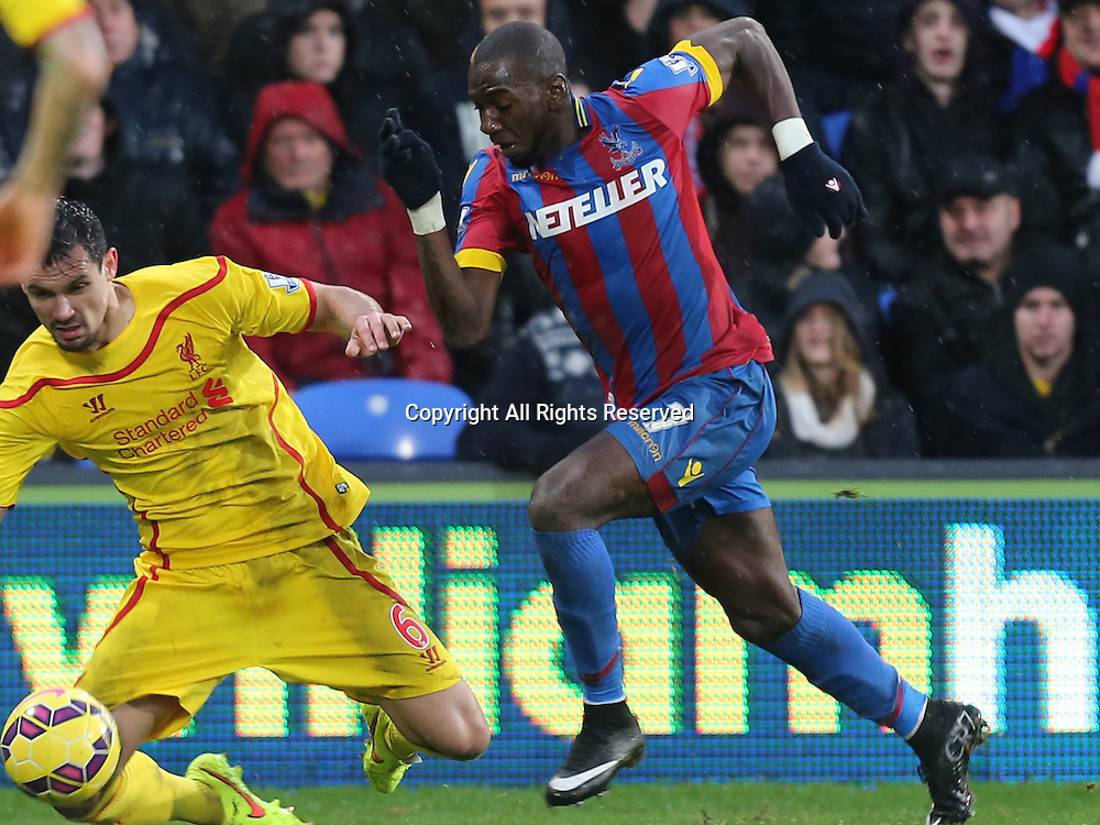 23.11.2014.  London, England. Premier League. Crystal Palace versus Liverpool. Yannick Bolasie is taken down by Dejan Lovren