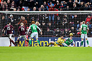 Don Cowie (#15) of Heart of Midlothian scores Heart of Midlothian's first goal (1-0) as Ofir Marciano (#1) of Hibernian and John McGinn (#7) of Hibernian fail to clear the ball off the goal line during the William Hill Scottish Cup 4th round match between Heart of Midlothian and Hibernian at Tynecastle Stadium, Gorgie, Scotland on 21 January 2018. Photo by Craig Doyle.