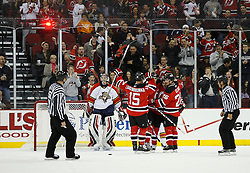 Feb 28, 2009; Newark, NJ, USA; The New Jersey Devils celebrate a goal by New Jersey Devils center Travis Zajac (19) during the second period at the Prudential Center.