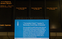 © Licensed to London News Pictures. 13/12/2016. London, UK. A screen displays details of strike action at Victoria Station. Today is the first day of three days of train strikes this week. Unions are opposed to management plans to give responsibility to drivers for closing the passenger doors at the station.  Photo credit: Peter Macdiarmid/LNP