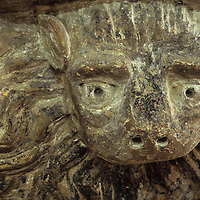 Naïve 16th century stone carving of lions head with wavy mane in church in Norfolk East Anglia England UK