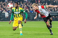 ROTTERDAM - Feyenoord - ADO Den Haag , Voetbal , KNVB Beker , Seizoen 2016/2017 , De Kuip , 14-12-2016 , grote kans va Feyenoord speler Dirk Kuyt (r) in duel met ADO Den Haag speler Wilfried Kanon (l)