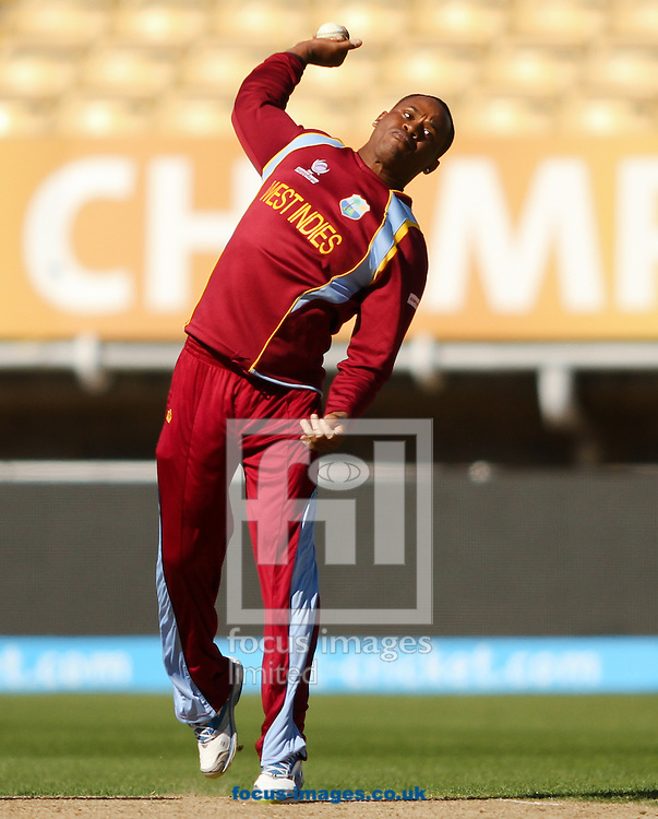 Picture by Tom Smith/Focus Images Ltd 07545141164<br /> 04/06/2013<br /> Marlon Samuels of West Indies bowling during the ICC Champions Trophy warm up match at Edgbaston, Birmingham.