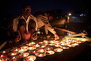 Candles lit on board a rowing boat in preparation for prayer offerings on the river Ganges in Varanasi, Uttar Pradesh, India