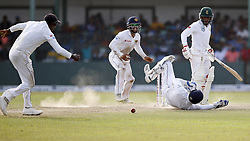 July 22, 2018 - Colombo, Sri Lanka - South African cricketer Temba Bavuma (4L) looks on as Sri Lankan wicket keeper Niroshan Dickwella misses a catch during the 3rd day's play in the 2nd test cricket match between Sri Lanka and South Africa at SSC International Cricket ground, Colombo, Sri Lanka on Sunday  22 July 2018  (Credit Image: © Tharaka Basnayaka/NurPhoto via ZUMA Press)