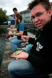 UK ENGLAND LONDON 10AUG06 - Angling instructor Jack Stephens displays a perch he has caught in the Canada Water Docks in East London. Thames 21 Angling Development Project at Canada Water Dock, London seeks to introduce and involve inner-city children with angling around various locations in London...jre/Photo by Jiri Rezac..© Jiri Rezac 2006..Contact: +44 (0) 7050 110 417.Mobile:  +44 (0) 7801 337 683.Office:  +44 (0) 20 8968 9635..Email:   jiri@jirirezac.com.Web:    www.jirirezac.com..© All images Jiri Rezac 2006 - All rights reserved.