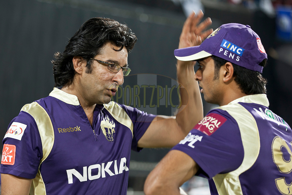 Washim Akram (L) gives a brief to Jaydeb during match 42 of the Indian Premier League ( IPL ) between the Deccan Chargers and the Kolkata Knight Riders held at the Rajiv Gandhi International Cricket Stadium in Hyderabad on the 3rd May 2011..Photo by Saikat Das/BCCI/SPORTZPICS.