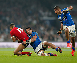 England Winger Anthony Watson is tackled by Samoa Flanker Maurie Fa'asavalu - Photo mandatory by-line: Rogan Thomson/JMP - 07966 386802 - 22/11/2014 - SPORT - RUGBY UNION - London, England - Twickenham Stadium - England v Samoa - QBE Autumn Internationals.