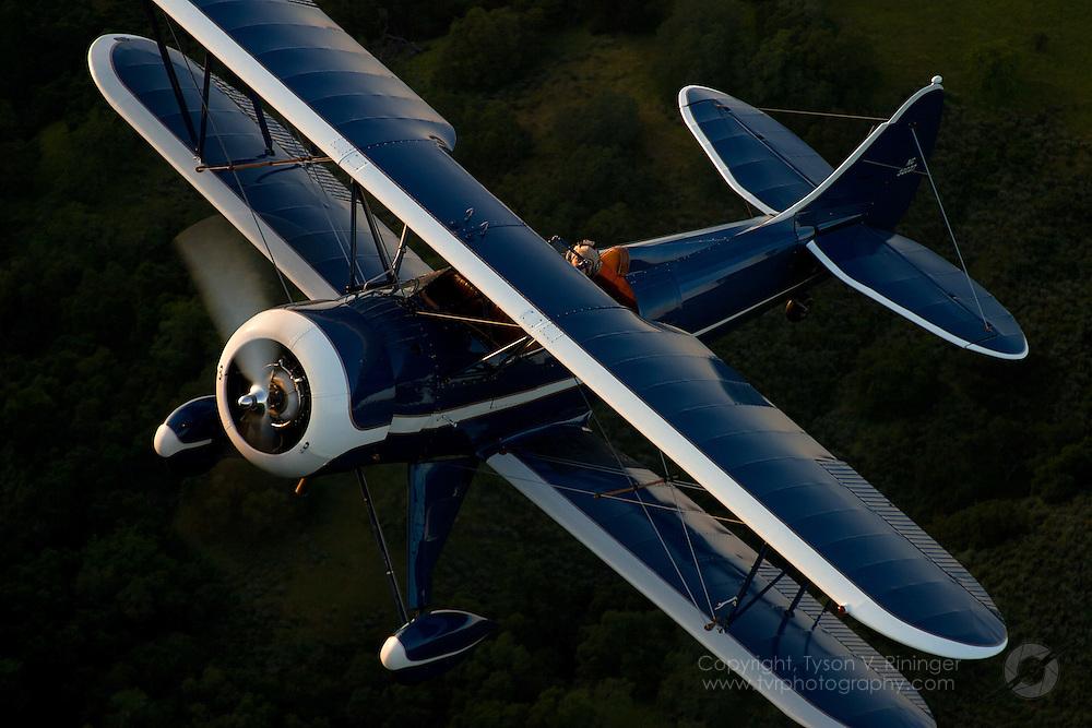 Lonnie Autry, Jr. flies a 1941 Waco UPF-7 NC32027 near Hollister, California.