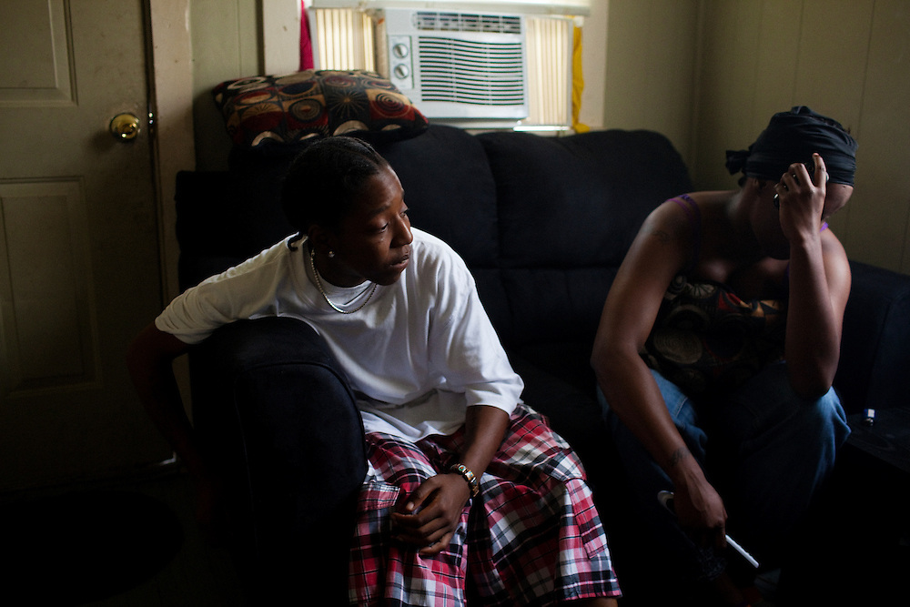 """Adrian """"Nikki"""" Wilson and her girlfriend Dominique """"Toot"""" Johnson sit in the living room of the home they share in the Baptist Town neighborhood of Greenwood, Mississippi on May 25, 2011."""