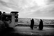BAM, Iran - Two Imams pray for the dead who kept arriving at the mass graves. More than 35 000 people died in the quake that devastated the ancient city.