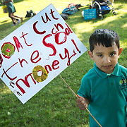 London Fields, Hackney. Protest against government plans to cut over 600 teachers in Hackney.A little boy from reception class holds a sign saying 'Don't cut the school money'.(photo by Jenny Matthews/In Pictures via Getty Images)