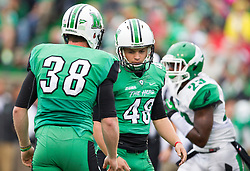 Oct 24, 2015; Huntington, WV, USA; Marshall Thundering Herd place kicker Nick Smith (48) celebrates with punter Tyler Williams (38) after making a field goal against the North Texas Mean Green during the first quarter at Joan C. Edwards Stadium. Mandatory Credit: Ben Queen-USA TODAY Sports