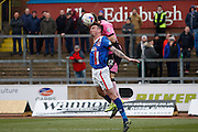 Carlisle United Defender Michael Raynes and Northampton Town Defender Luke Prosser challenge the ball during the Sky Bet League 2 match between Carlisle United and Northampton Town at Brunton Park, Carlisle, England on 5 March 2016. Photo by Craig McAllister.