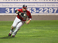 TinCaps left fielder Jaff Decker (22) fields a ball in game three of the Midwest League Championship at Community Field in Burlington, Iowa on September 17, 2009.