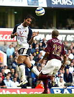 Photo: Chris Ratcliffe.<br />Tottenham Hotspur v Arsenal. The Barclays Premiership.<br />29/10/2005.<br />Mido gets above Gael Clichy at White Hart Lane