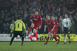LUTON, ENGLAND - SATURDAY, JANUARY 7th, 2006: Liverpool's Xabi Alonso rounds Luton Town's goalkeeper Marlon Beresford to score the fifth goal during the FA Cup 3rd Round match at Kenilworth Road. (Pic by David Rawcliffe/Propaganda)