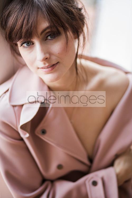 Portrait of Woman Wearing Pink Overcoat
