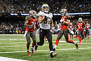 NEW ORLEANS, LA - SEPTEMBER 20:  Willie Snead #83 of the New Orleans Saints runs a pass in for a touchdown against the Tampa Bay Buccaneers at Mercedes-Benz Superdome on September 20, 2015 in New Orleans Louisiana.  The Buccaneers defeated the Saints 26-19. (Photo by Wesley Hitt/Getty Images) *** Local Caption *** Willie Snead