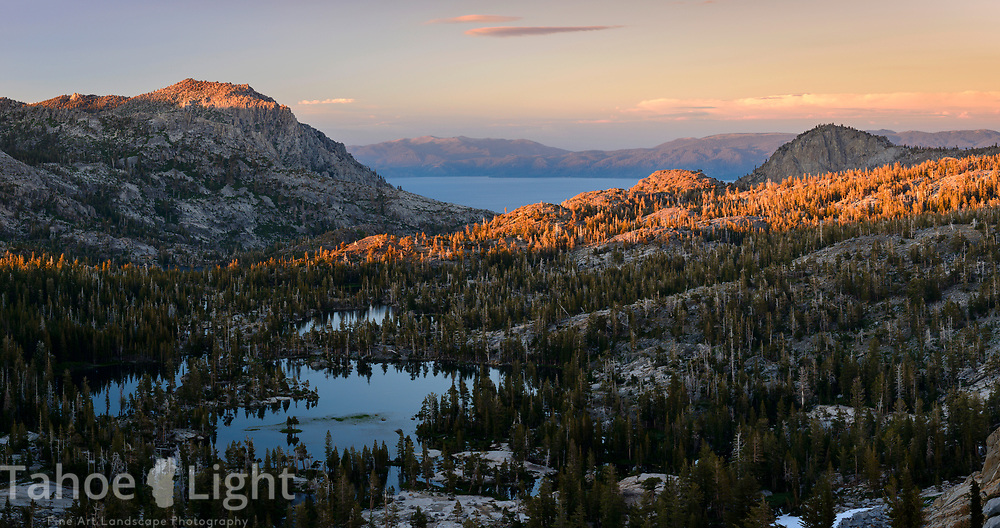 Upper Velma Lake and Lake Tahoe at sunset as seen from Fontanelles lake in Desolation Wilderness.
