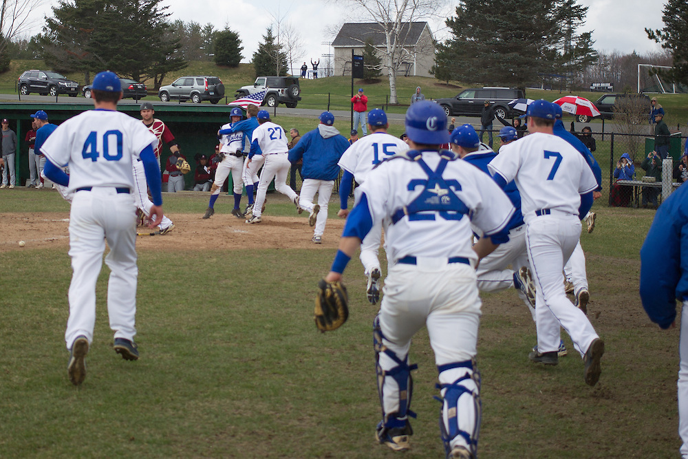 Colby College celebrates a win over Bates College during a NCAA Division III baseball game on April 25, 2014 in Waterville, ME. (Dustin Satloff/Colby Athletics)