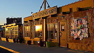 USA: California: San Bernadino County: Joshua Tree: The Crossroads Cafe at sunrise attracts visitors from around the world, there to explore and discover Joshua Tree National Park.