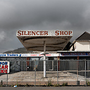 Dark, gritty shot of Silencer automotive Shop, Woodstock, Cape Town