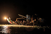 Traditional sulfur fire fishing as practiced near Jinshan on Taiwan's north coast. Only 3-4 boats still practice this traditional technique in a practice passed down through generations.