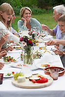 Family dining in garden