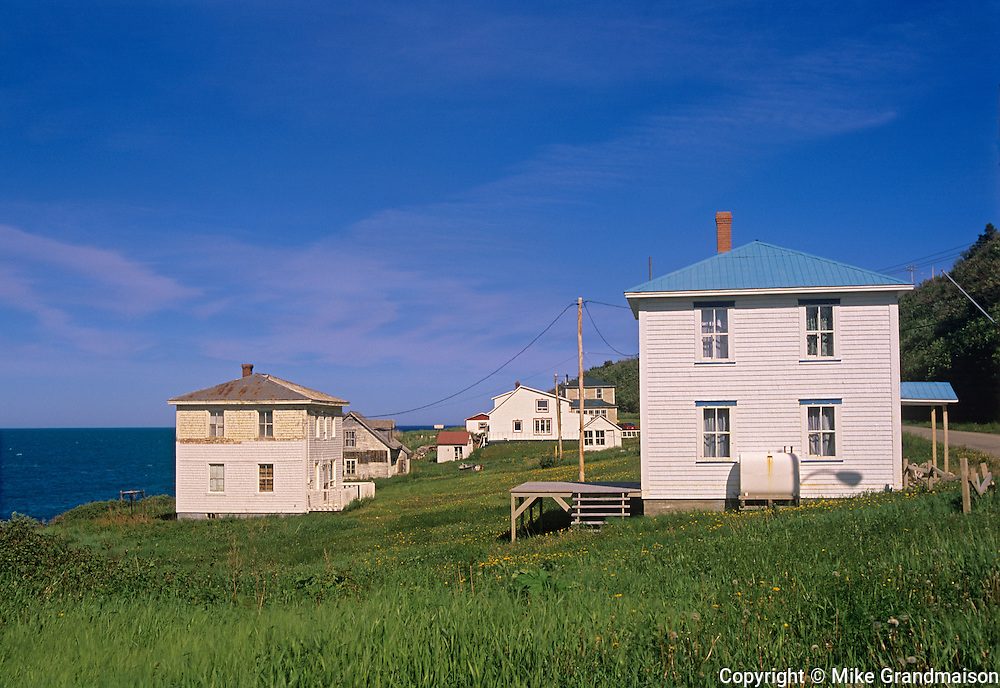 Houses on coastal shore line of Gulf of St. Lawrence<br /> CLoridorme<br /> Quebec<br /> Canada