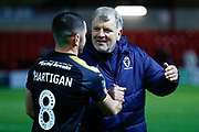 Wimbledon Assistant Glynn Hodges congratulates goal scorer Wimbledon midfielder Anthony Hartigan (8)  during the The FA Cup 3rd round match between Fleetwood Town and AFC Wimbledon at the Highbury Stadium, Fleetwood, England on 5 January 2019.