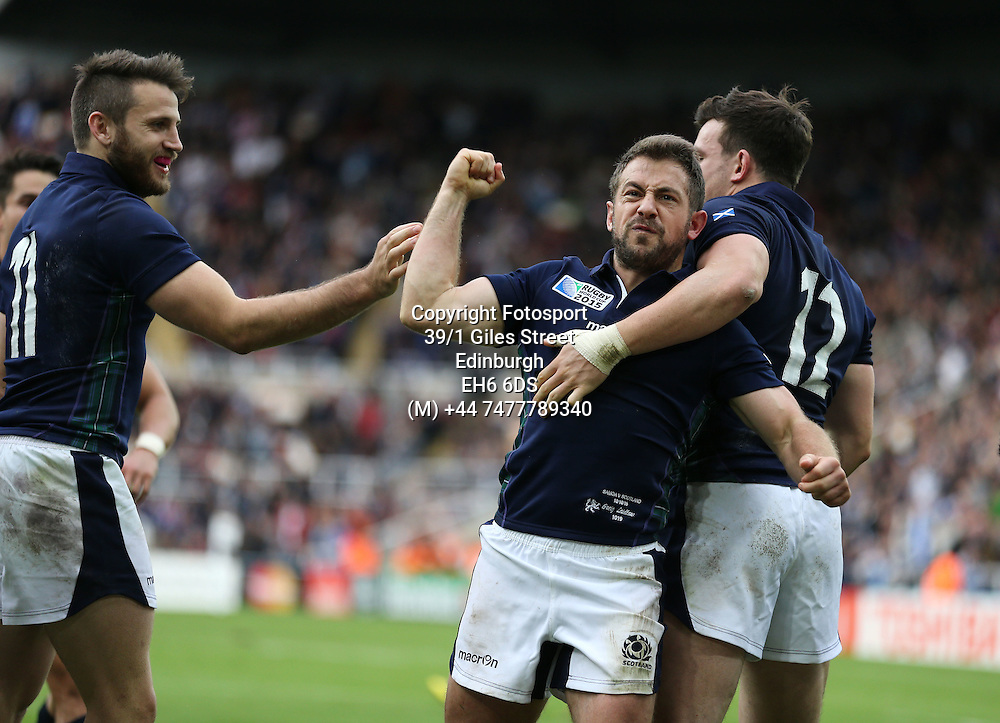 Greig Laidlaw - Scotland captain is ecstatic as he celebrates his match winning try, flanked by Tommy Seymour (L) and Matt Scott (R) late in the game to take Scotland into the quarter finals of the Rugby World Cup.<br />Scotland v Samoa, Rugby World Cup, Pool B, St James' Park, Newcastle, England, Saturday 10 October 2015<br />***PLEASE CREDIT: FOTOSPORT/DAVID GIBSON***<br /><br /><br />Scotland v Samoa, Rugby World Cup, Pool B, St James' Park, Newcastle, England, Saturday 10 October 2015<br />***PLEASE CREDIT: FOTOSPORT/DAVID GIBSON***