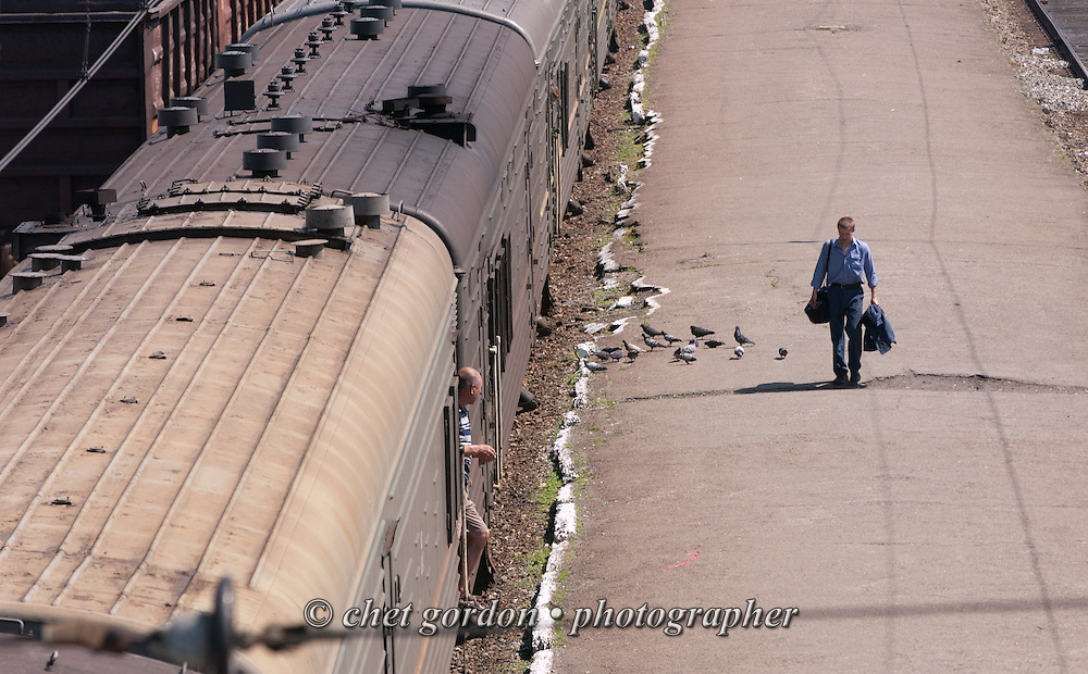 A man walks on the platform at the Tiaga Railway Station in Tiaga, Siberia Russian Federation on Monday, June, 13, 2005.