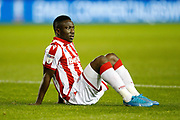 Peter Etebo of Stoke City goes down injured during the EFL Sky Bet Championship match between Sheffield Wednesday and Stoke City at Hillsborough, Sheffield, England on 22 October 2019.